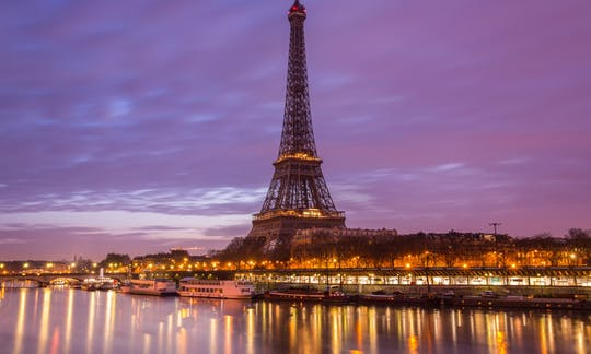 Paris-by-night tour with Eiffel Tower skip-the-line tickets, bus tour and Seine cruise