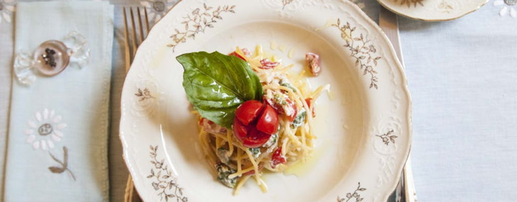 Market tour, cooking class and lunch or dinner at a Cesarina's home in Naples