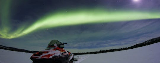 Northern lights hunt by snowmobile