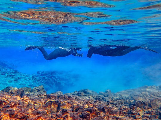 Snorkel between Continents in Silfra