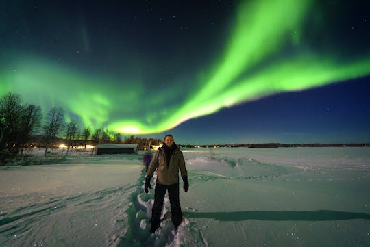 Single Rider Snowmobile Search for Northern Lights – Night