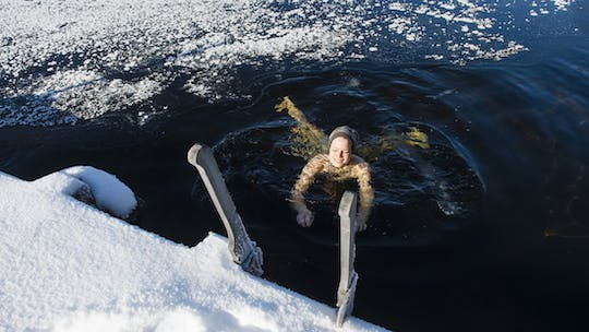 Arctic experience with ice swimming and Finnish sauna