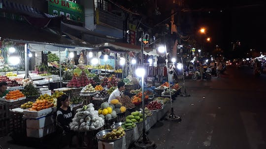 Walking market food tour by night in Ho Chi Minh city