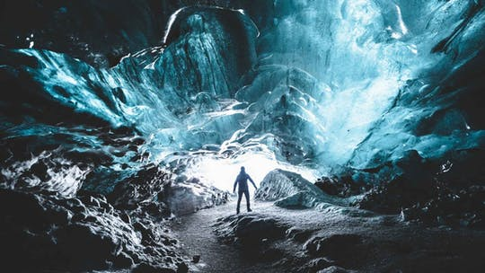 Explore a blue ice cave