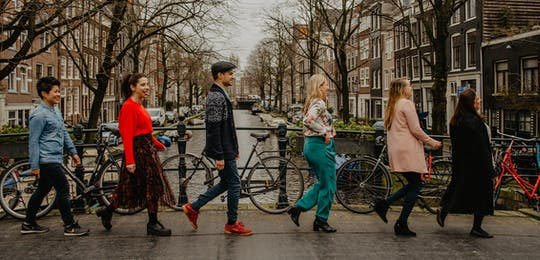 Who is Amsterdam 4-hour walking tour