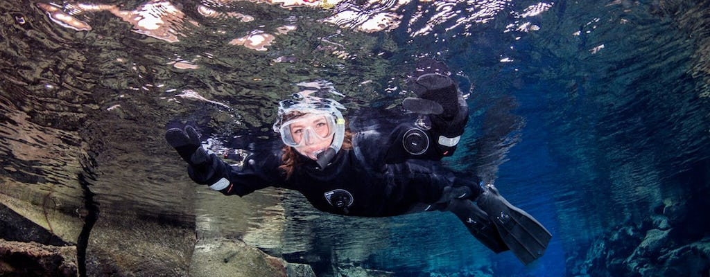 Enjoy a Silfra snorkel tour with pick-up