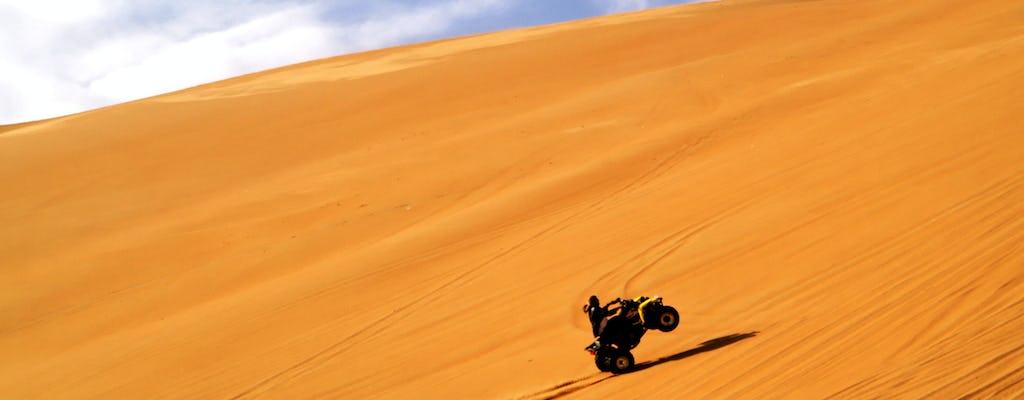 Tour de medio día en quad por las dunas rojas con paseo en camello, sandboard y barbacoa