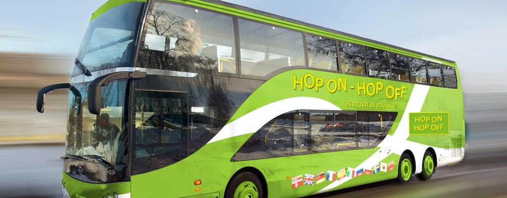Amsterdam Madame Tussauds entrance with 24-hour hop-on-hop-off bus and boat