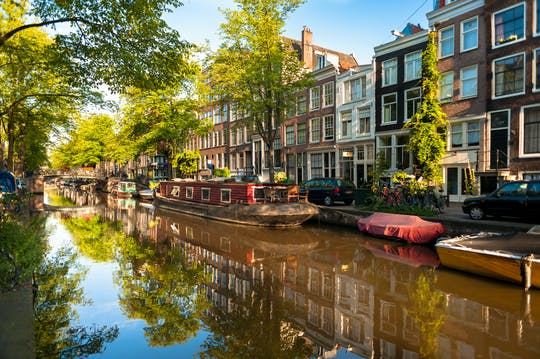 Historic Amsterdam canal small-group boat tour