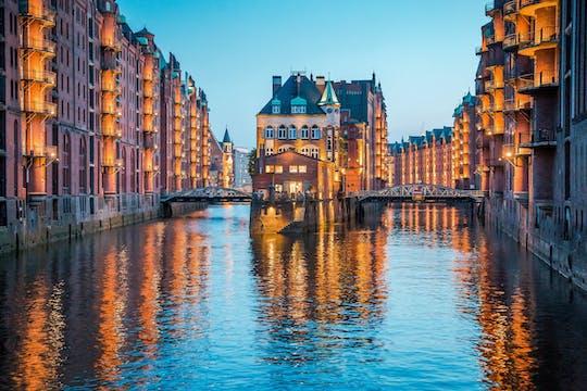 Evening cruise through the illuminated harbor of Hamburg