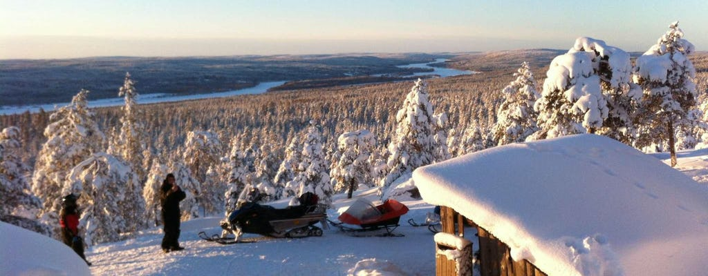 Snowmobile safari through Lappish forest