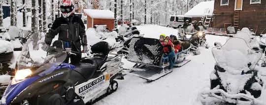 Arctic Circle sleigh ride by snowmobile