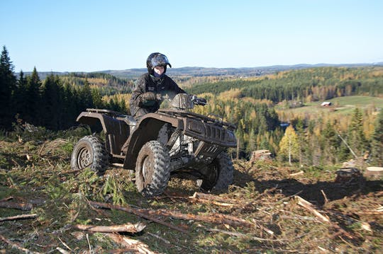 Quad bike safari through a Finnish forest