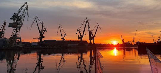 Sunset on the shipyard and old town cruise in Gdansk