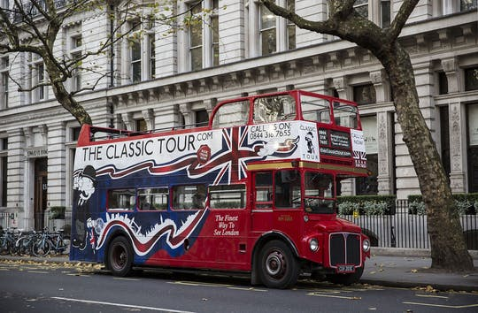 Classic London sightseeing tour in a vintage bus