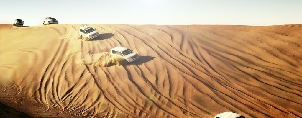 Red dunes safari with sandboarding, camel ride and BBQ