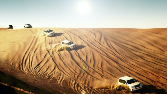 Red dunes safari with camel ride, sandboarding and BBQ