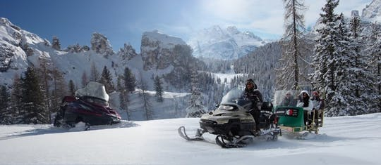'The Great Dolomites Road' with snowmobile and sledding experience private tour