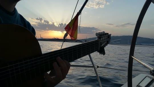 Experiencia de navegación al atardecer en Barcelona con guitarra española en vivo