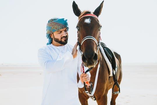 Horseback ride through Dubai desert park