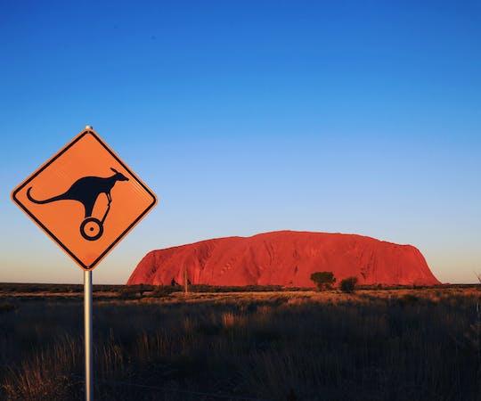 Quarter Uluru self-balancing scooter and sunset