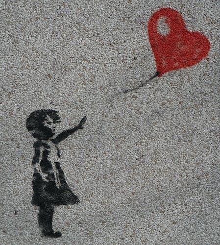 Banksy girl and balloon cut.jpg
